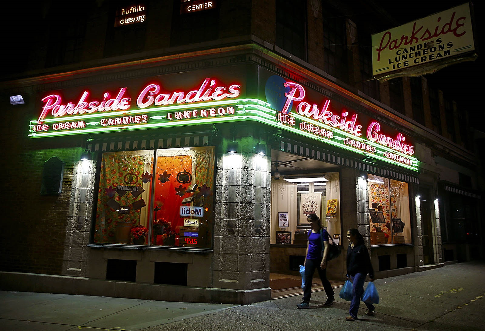 Parkside Candies recently restored neon sign lites up Main Street.